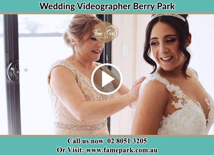 A woman helping the Bride to get ready for the wedding Berry Park NSW 2321