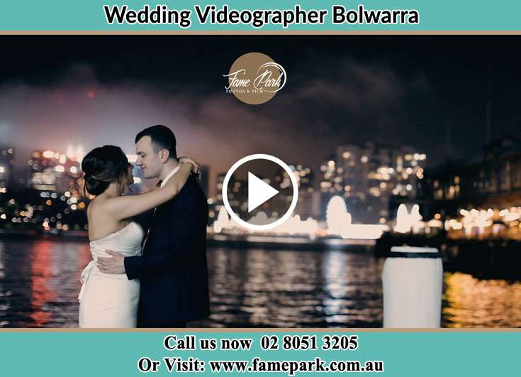 Bride and Groom kissed at the shore Bolwarra NSW 2320