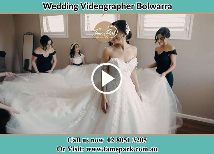 The girls spread out the wedding gown wore by the Bride Bolwarra NSW 2320