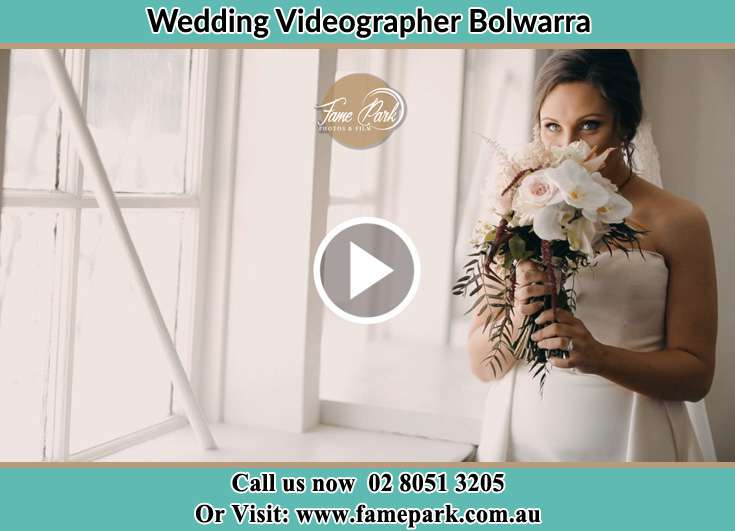 The Bride smelling the bouquet of flowers Bolwarra NSW 2320