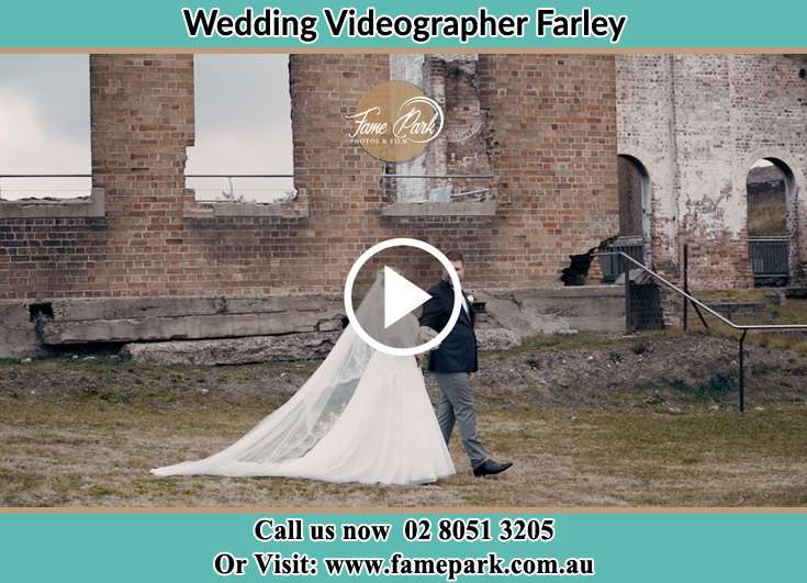 The Groom and the Bride walking through the ruins Farley NSW 2320