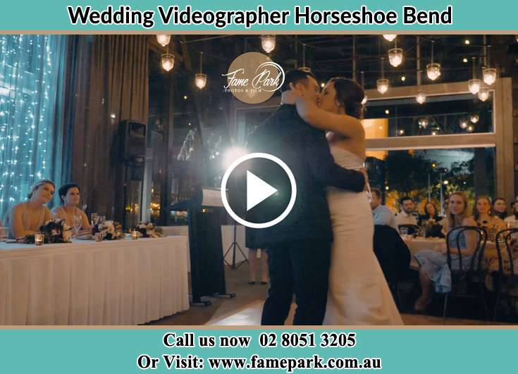 The new couple kissing on the dance floor Horseshoe Bend NSW 2320