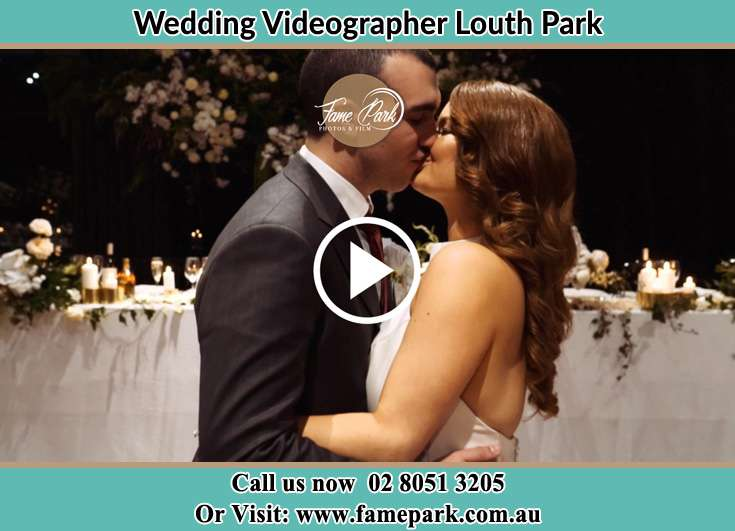 The newlyweds kissing Louth Park NSW 2320
