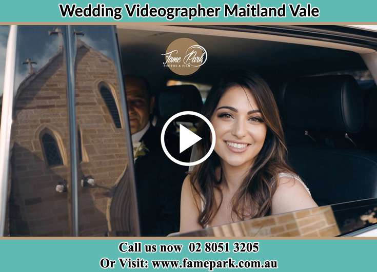The Bride smiles for the camera inside the wedding car Maitland Vale NSW 2320