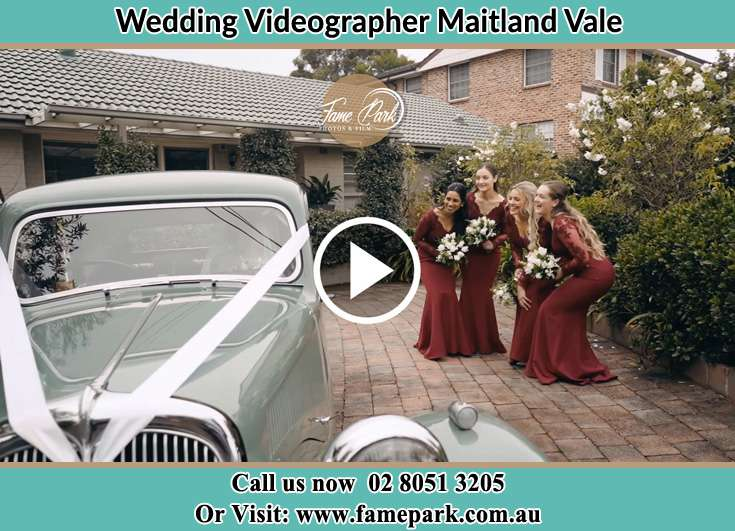 The girls looking at the wedding car Maitland Vale NSW 2320