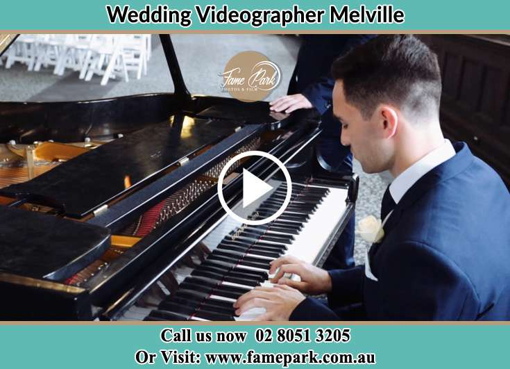 The Groom playing the piano Melville NSW 2320