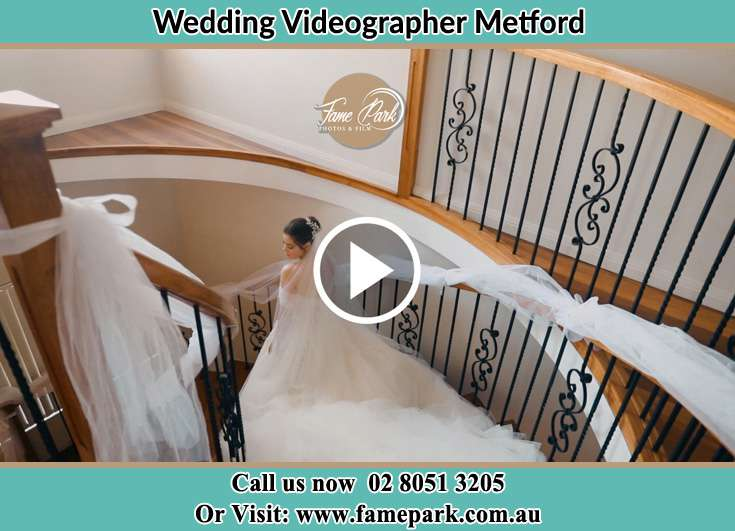 The Bride walking downstairs Metford NSW 2323