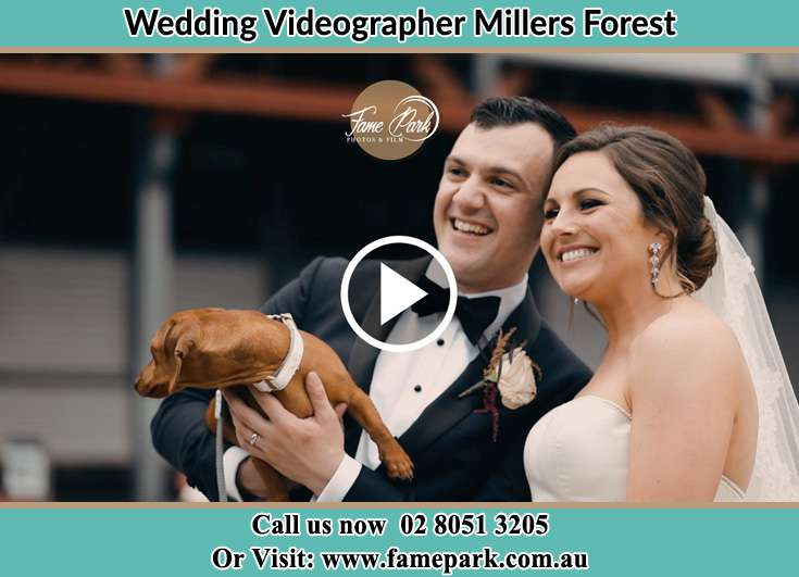 The new couple smiling for the camera with their dog Millers Forest NSW 2324