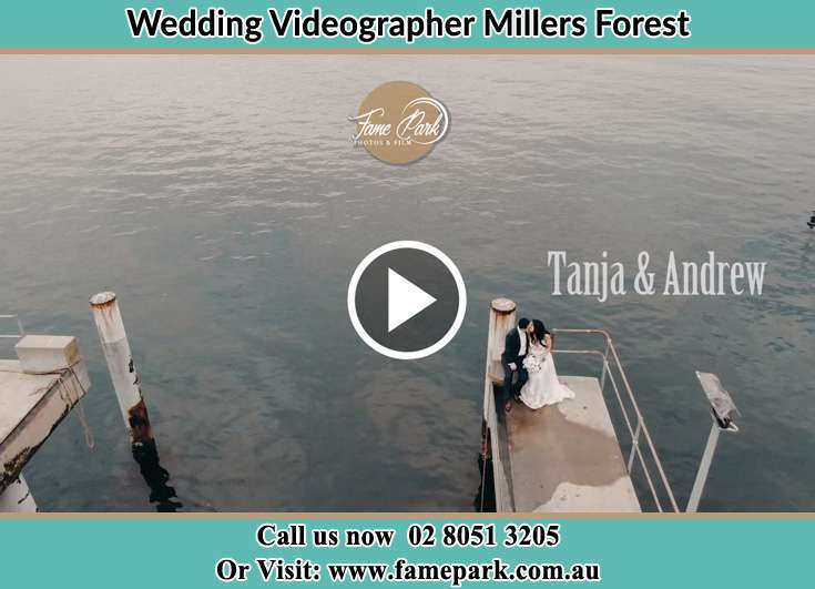 The newlyweds kissing in the harbor Millers Forest NSW 2324