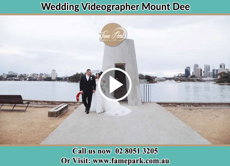 The newlyweds walking away from the shore Mount Dee NSW 2320