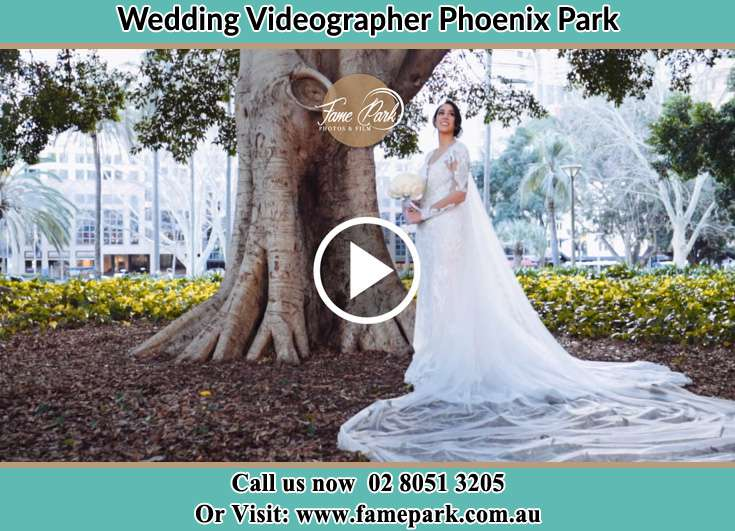 The Bride holding a bouquet of flowers under the tree Phoenix Park NSW 2321