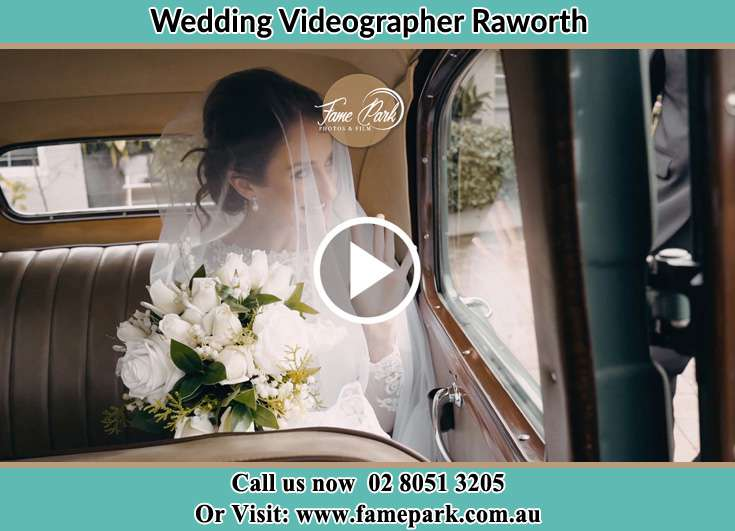 The Bride holding a bouquet of flowers inside the wedding car Raworth NSW 2321