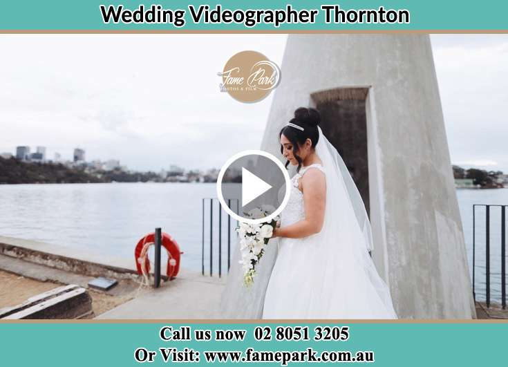 The Bride holding a bouquet of flowers near the shore Thornton NSW 2322