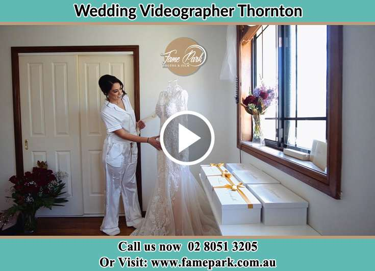 The Bride checking her wedding dress Thornton NSW 2322