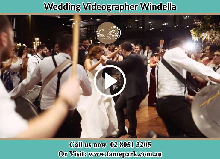 The newlyweds dancing on the dance floor with the band Windella NSW 2320