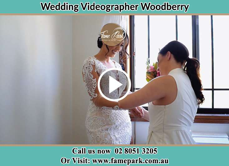 A woman helping the Bride to get ready for the wedding Woodberry NSW 2322