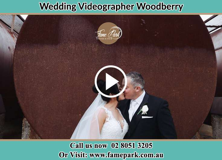 The newlyweds kissing Woodberry NSW 2322